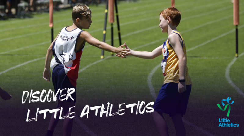 Two boys shaking hands at the end of a running race.
